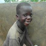 Boy pumping water